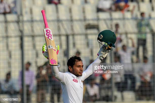 Bangladesh cricketer Mushfiqur Rahim celebrates his century during the first day of the second Test cricket match between Bangladesh and Zimbabwe at...