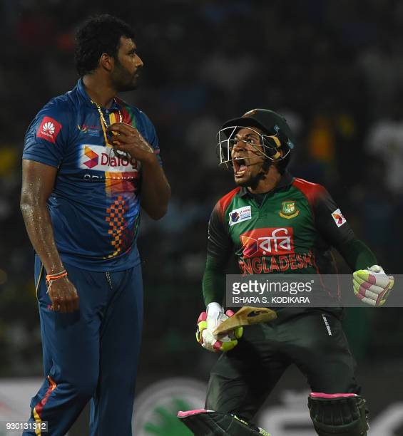 TOPSHOT Bangladesh cricketer Mushfiqur Rahim celebrates his team's five wicket victory over Sri Lanka as Sri Lankan cricketer Thisara Perera looks on...