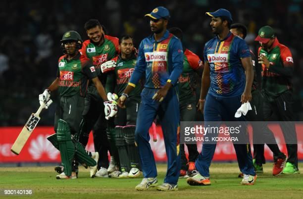 Bangladesh cricketer Mushfiqur Rahim celebrates with teammates after their five wicket victory over Sri Lanka in the third Twenty20 international...