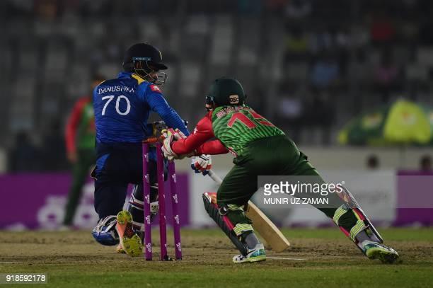 Bangladesh cricketer Mushfiqur Rahim successfully breaks the stumps of the Sri Lanka cricketer Danushka Gunathilaka during the first Twenty20 cricket...