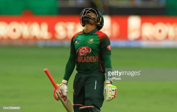 Bangladesh cricketer Mushfiqur Rahim walsk back following his dismissal during the final cricket match of Asia Cup 2018 between India and Bangladesh...
