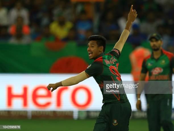 Bangladesh cricketer Mustafizur Rahman appeals during the final cricket match of Asia Cup 2018 between India and Bangladesh at Dubai International...