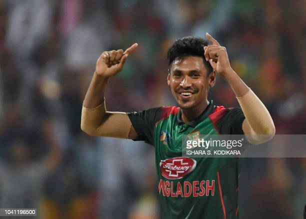 Bangladesh cricketer Mustafizur Rahman celebrates after he dismissed Pakistan batsman Mohammad Nawaz during the one day international Asia Cup...