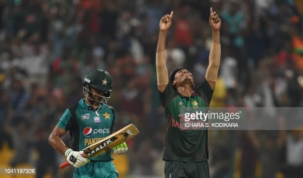 Bangladesh cricketer Mustafizur Rahman celebrates after he dismissed Pakistan batsman Hasan Ali during the one day international Asia Cup cricket...