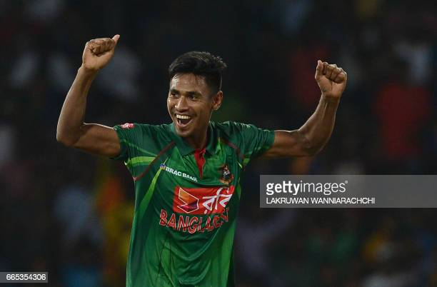 Bangladesh cricketer Mustafizur Rahman celebrates after he dismissed Sri Lankan cricketer Chamara Kapugedera during the second T20 international...