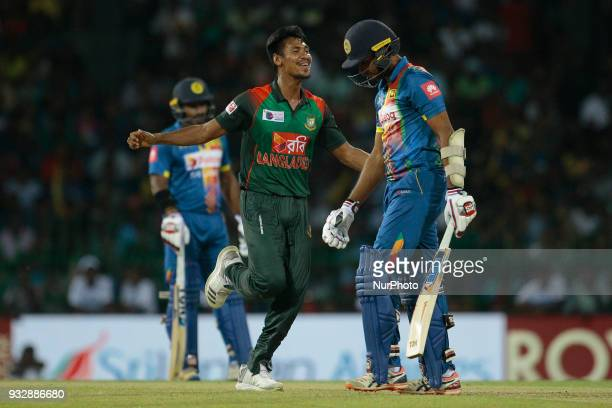 Bangladesh cricketer Mustafizur Rahman celebrates after taking the wicket of Sri Lankan cricketer Dasun Shanaka during the 6th T20 cricket match of...