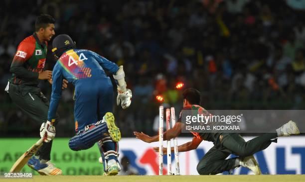 TOPSHOT Bangladesh cricketer Mustafizur Rahman dismisses Sri Lanka's Upul Tharanga during the sixth Twenty20 international cricket match between...