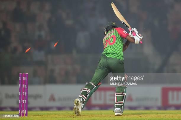 Bangladesh cricketer Mustafizur Rahman is bowled by the Sri Lanka cricketer Danushka Gunathilaka during the second Twenty20 cricket match between...