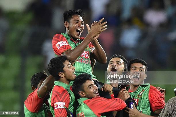 Bangladesh cricketer Mustafizur Rahman is lifted by his teammates after winning the second ODI cricket match between Bangladesh and India at the...