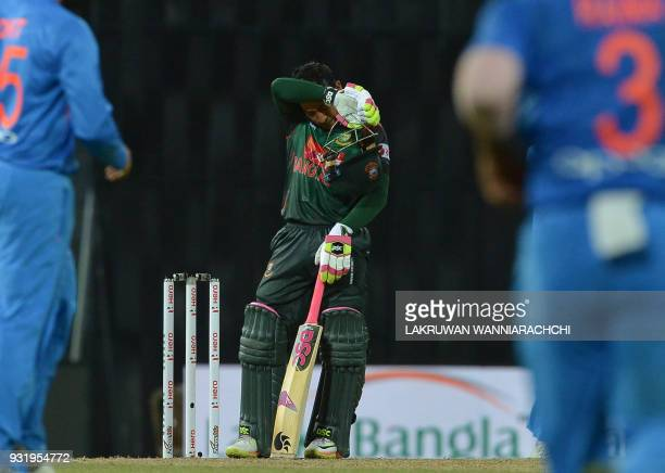 Bangladesh cricketer Mustafizur Rahman reacts after losing to India by 17 runs during the Fifth Match Nidahas Twenty20 TriSeries international...