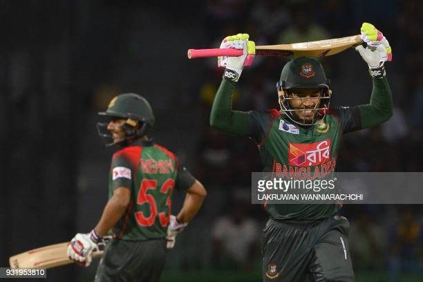 Bangladesh cricketer Mustafizur Rahman runs between wickets next to teammate Sabbir Rahman during the Fifth Match Nidahas Twenty20 TriSeries...