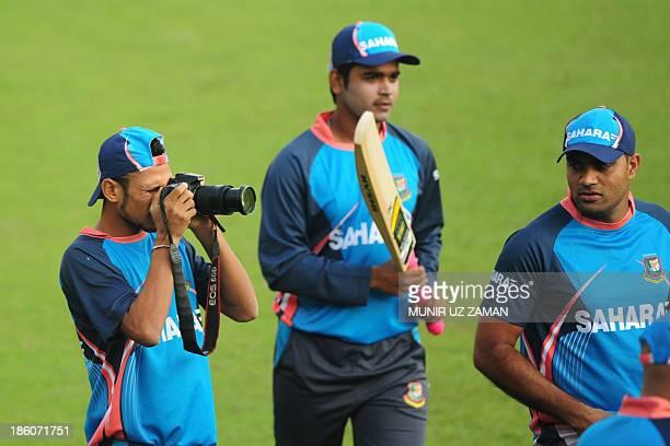 Bangladesh cricketer Nasir Hossain uses the Bangladesh Cricket Board photographer's camera during a training session at the Sher-e Bangla National...