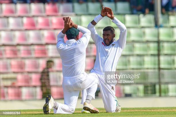 Bangladesh cricketer Nazmul Islam celebrates after the dismissal of Zimbabwe cricketer Sikandar Raza during the first day of the first Test cricket...