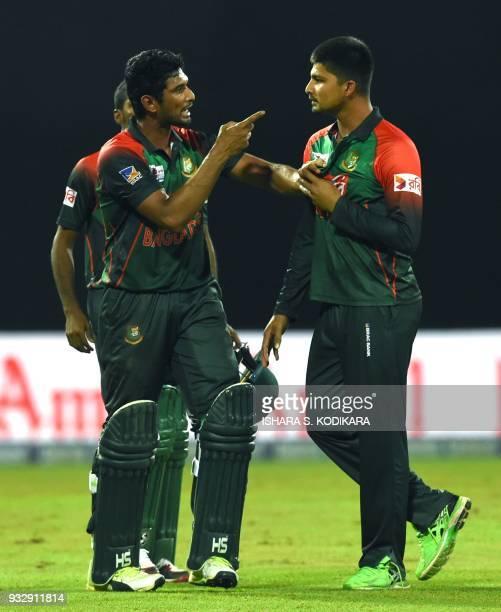 Bangladesh cricketer Nurul Hasan exchanges words with Bangladesh cricketer Mahmudull during the sixth Twenty20 international cricket match between...