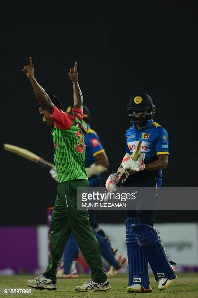 Bangladesh cricketer Rubel Hossain celebrates after the dismissal of the Sri Lanka cricketer Niroshan Dickwella during the first Twenty20 cricket...