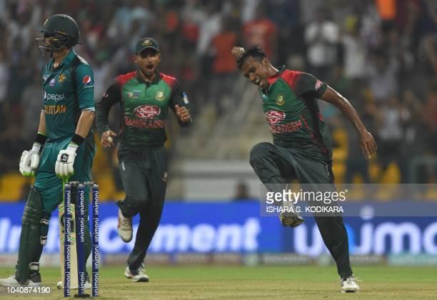 Bangladesh cricketer Rubel Hossain celebrates with his teammates after he dismissed Pakistan batsman Shoaib Malik during the one day international...