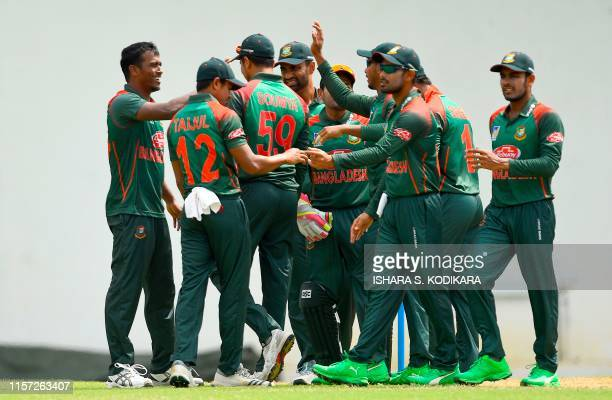 Bangladesh cricketer Rubel Hossain celebrates with teammates after dismissing Sri Lanka Board President's XI cricketer Niroshan Dickwella during the...