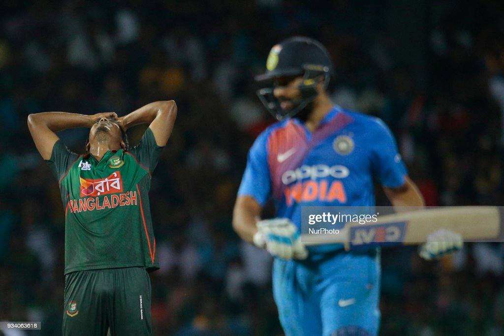 Bangladesh cricketer Rubel Hossain (L) reatcs as Indian cricket captain Rohit Sharma plays a shot during the final Twenty-20 cricket match of NIDAHAS Trophy between Bangladesh and India at R Premadasa cricket ground, Colombo, Sri Lanka on Sunday 18 March 2018.