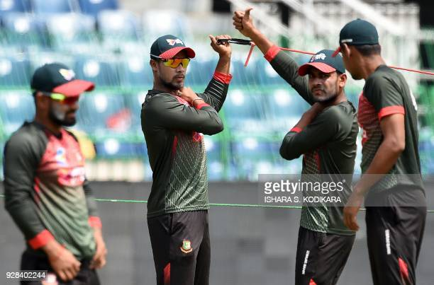 Bangladesh cricketer Sabbir Rahman and teammates stretches during a practice session at R Premadasa International Cricket Stadium in Colombo on March...