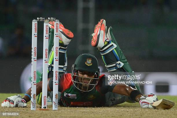 TOPSHOT Bangladesh cricketer Sabbir Rahman successfully dives and avoids being run out during the Fifth Match Nidahas Twenty20 TriSeries...