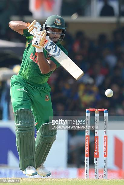 Bangladesh cricketer Shakib Al Hasan hits a ball to the boundary during the third and final one day international cricket match between Sri Lanka and...