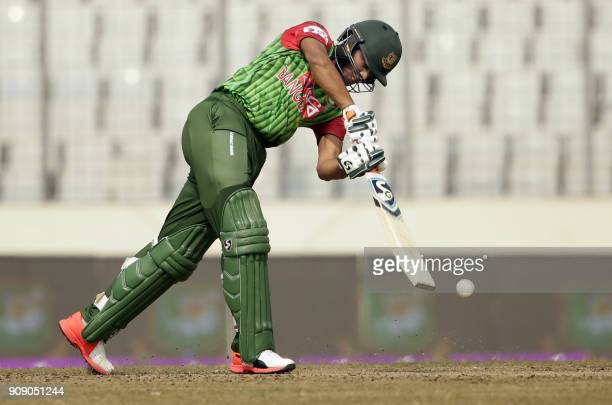 Bangladesh cricketer Shakib Al Hasan plays a shot during the fifth one day international cricket match in the TriNations Series between Sri Lanka and...