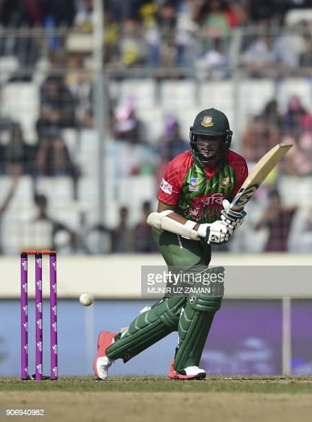 Bangladesh cricketer Shakib Al Hasan plays a shot during the third one day international cricket match of the TriNations Series between Bangladesh...