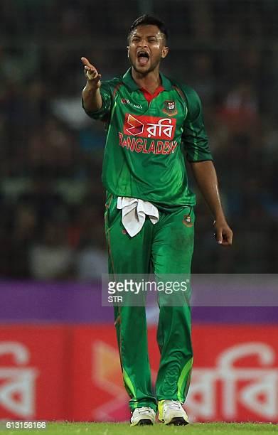 Bangladesh cricketer Shakib Al Hasan reacts during the first one day international cricket match between Bangladesh and England at the ShereBangla...