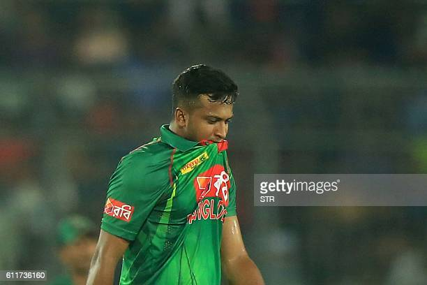 Bangladesh cricketer Shakib Al Hasan reacts during the third one day international cricket match between Bangladesh and Afghanistan at The...