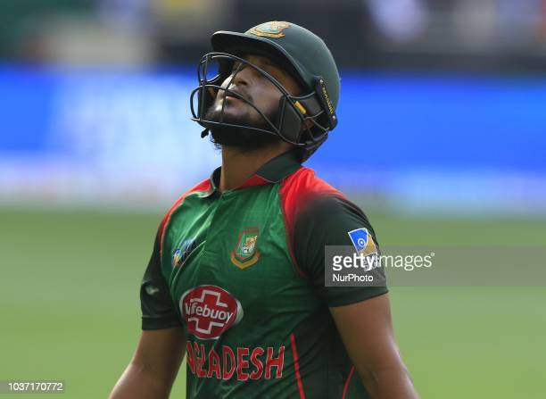 Bangladesh cricketer Shakib Al Hasan walks back to the pavilion following his dismissal during the 1st cricket match of the Super four group of Asia...