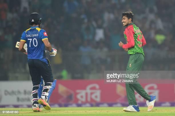 Bangladesh cricketer Soumya Sarkar celebrates after taking the wicket of the Sri Lanka cricketer Danushka Gunathilaka during the second Twenty20...