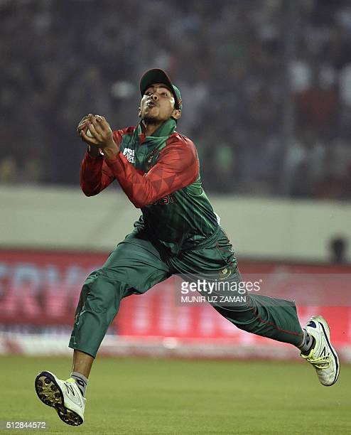 Bangladesh cricketer Soumya Sarkar takes a catch to dismiss Sri Lanka cricketer Tillakaratne Dilshan during the match between Bangladesh and Sri...