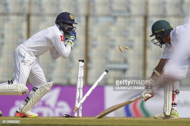Bangladesh cricketer Sunzamul Islam tries to make his ground as the Sri Lanka wicketkeeper Niroshan Dickwella successfully breaks the stumps during...