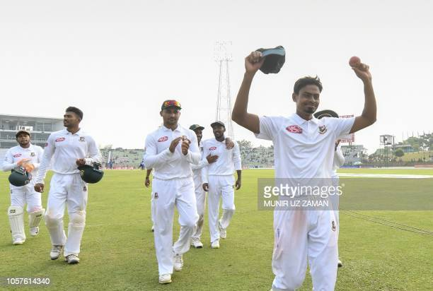 Bangladesh cricketer Taijul Islam acknowledges the crowd as he gets 11 wickets during the third day of the first Test cricket match between...