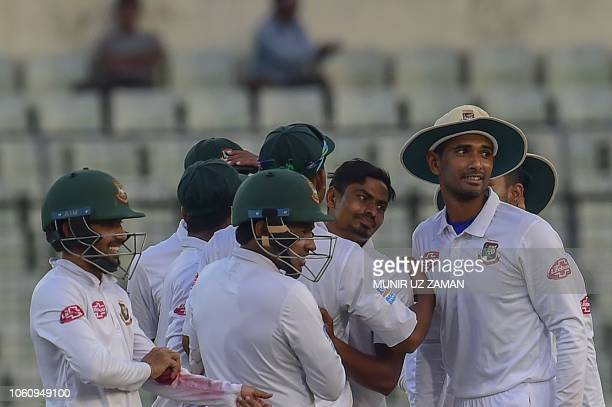 Bangladesh cricketer Taijul Islam celebrates with his teammates after the dismissal of the Zimbabwe cricketer Regis Chakabva during the third day of...