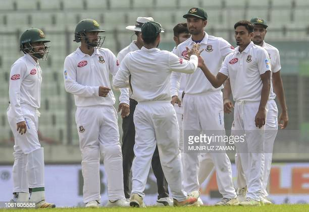 Bangladesh cricketer Taijul Islam celebrates with his teammates after the dismissal of the Zimbabwe cricketer Sikandar Raza during the fifth day of...