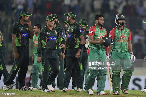 Bangladesh cricketer Tamim Iqbal and Shakib Al Hasan walk off the field after winning the second One Day International cricket match between...
