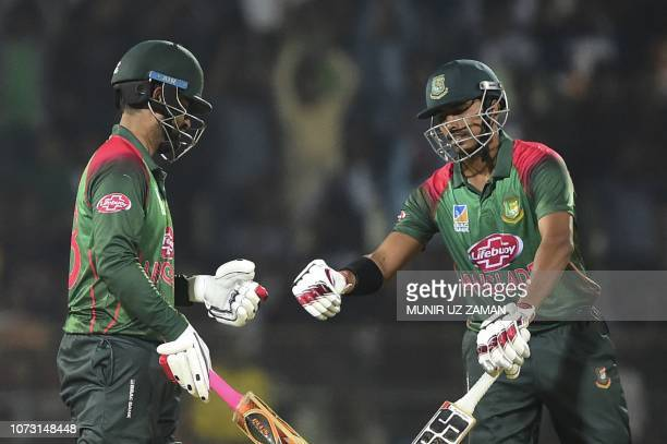 Bangladesh cricketer Tamim Iqbal celebrates with his teammate Soumya Sarkar after hitting a boundary during the third oneday international between...