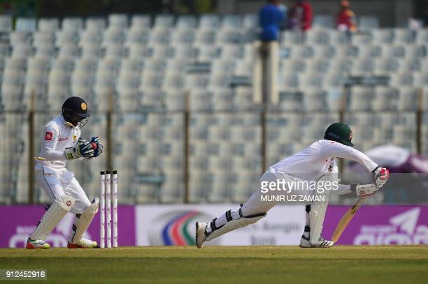Bangladesh cricketer Tamim Iqbal is bowled out by the Sri Lankan cricketer Dilruwan Perera as the wicketkeeper Niroshan Dickwella catches the ball...