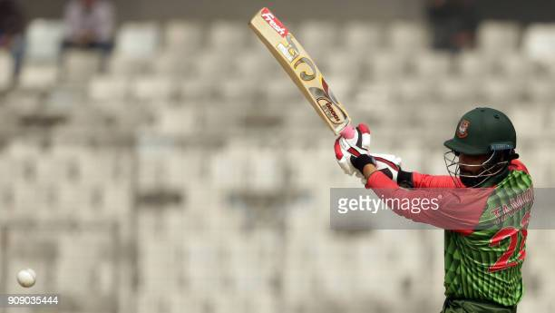 TOPSHOT Bangladesh cricketer Tamim Iqbal Khan plays a shot during the fifth one day international cricket match in the TriNations Series between Sri...