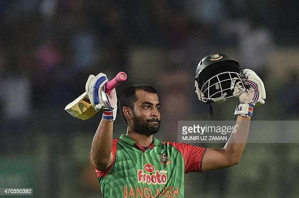 Bangladesh cricketer Tamim Iqbal reacts after scoring a century during the second One Day International cricket match between Bangladesh and Pakistan...