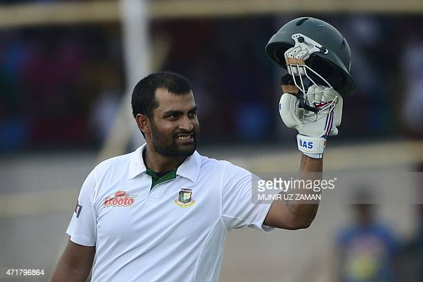 Bangladesh cricketer Tamim Iqbal reacts after scoring a century during the fourth day of the first cricket Test match between Bangladesh and Pakistan...