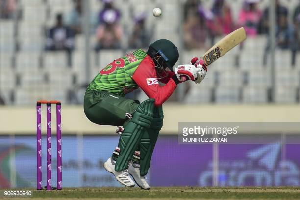 Bangladesh cricketer Tamim Iqbal tries to avoid a bouncer from Sri Lanka bowler Suranga Lakmal during the third one day international cricket match...