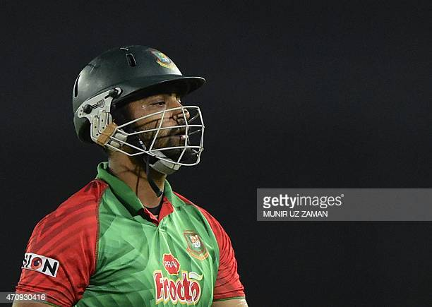 Bangladesh cricketer Tamim Iqbal walks off the field after being dismissed by Pakistan cricketer Umar Gul during the T20 match between Bangladesh and...