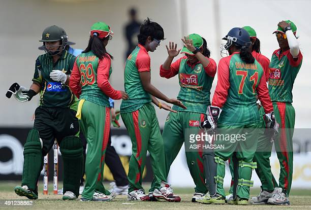 Bangladesh cricketers celebrate after the dismissal of Pakistani cricketer Nain Abidi during the first one day international cricket match between...