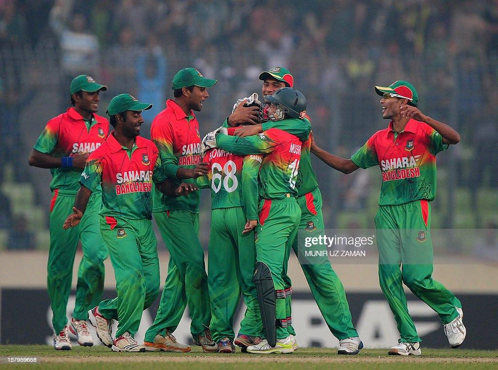 Bangladesh cricketers celebrate after the dismissal of the unseen West Indies batsman Kieron Pollard during the fifth one day international between Bangladesh and West Indies at The Sher-e-Bangla National Cricket Stadium in Dhaka on December 8, 2012. AFP PHOTO/ Munir uz ZAMAN
