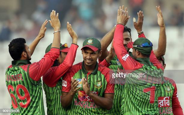 Bangladesh cricketers celebrate after the dismissal of Zimbabwe batsman Craig Ervine during the fifth one day international match in the TriNations...