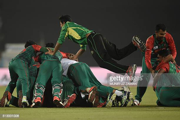 Bangladesh cricketers celebrate after winning the Asia Cup T20 cricket tournament match between Bangladesh and Pakistan at the ShereBangla National...