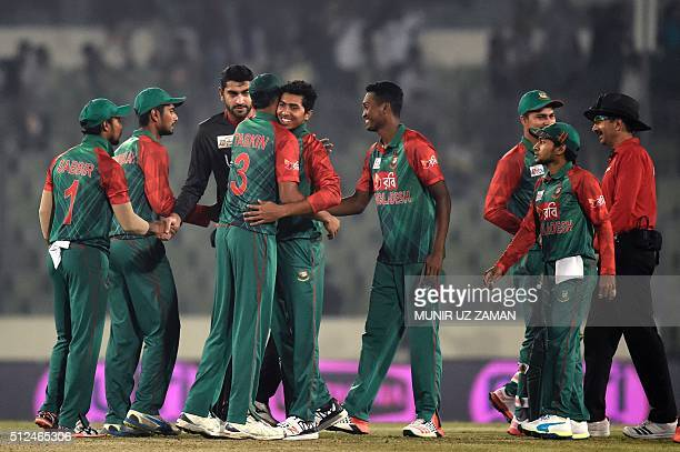 Bangladesh cricketers celebrate after winning the match between Bangladesh and United Arab Emirates at the Asia Cup T20 cricket tournament at the...