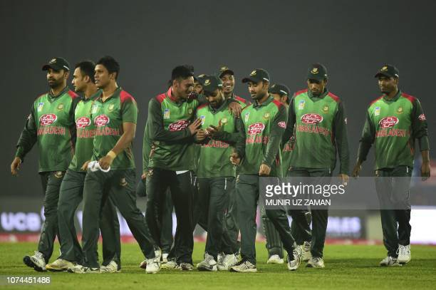 Bangladesh cricketers celebrate after winning the second Twenty20 cricket match between Bangladesh and West Indies at the ShereBangla National...